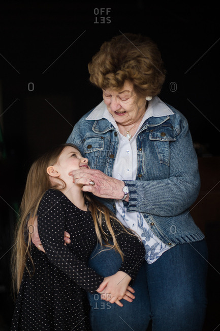 Grandmother with smiling granddaughter