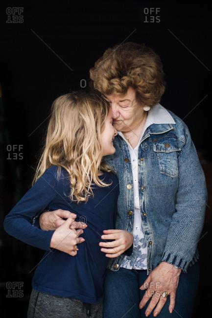 Grandmother giving hug to granddaughter