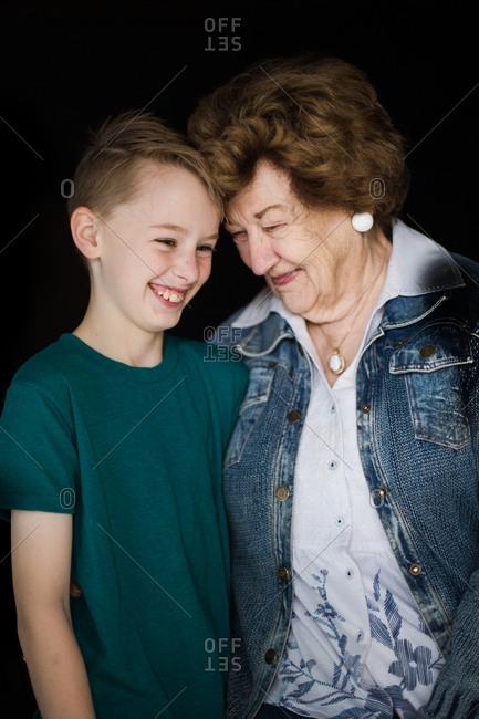 A smiling grandma and grandson