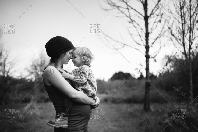 Mom with girl in a clearing