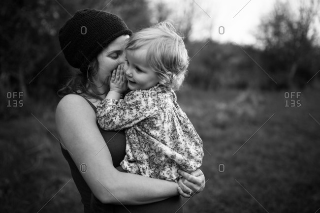 Playful girl with mom in clearing