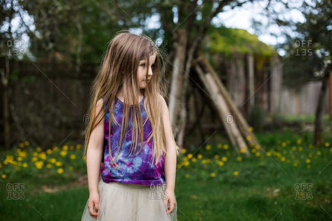 Girl in tutu in a summer yard