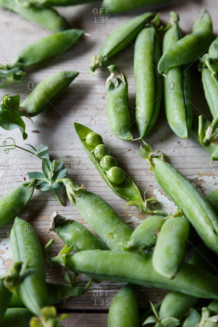 Fresh peas and pods on table