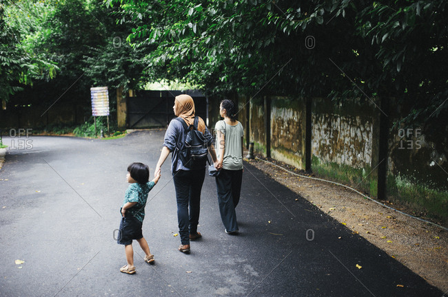 Boy with two women in Malaysian street