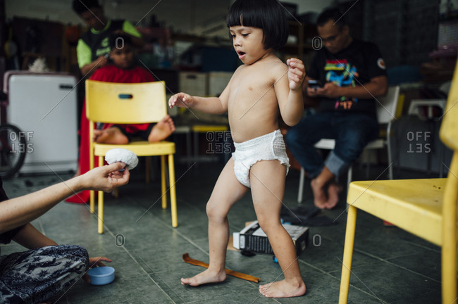 Toddler boy in barber shop in Malaysia