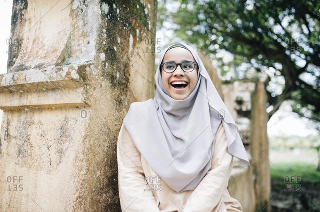 Laughing Malaysian woman in Islamic dress