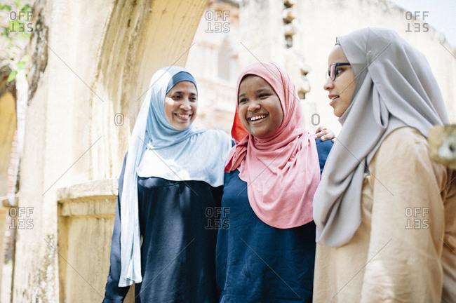 Three Malaysian women in Islamic dress