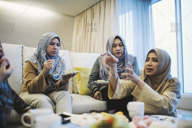 Malaysian women talking while eating
