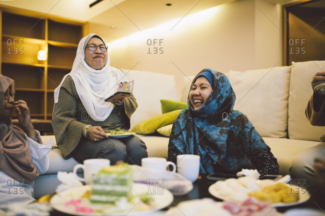 Malaysian women laughing while eating