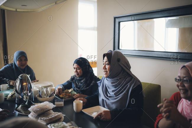 Malaysian women gathered at table
