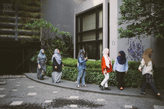 Group of Malaysian women outside building