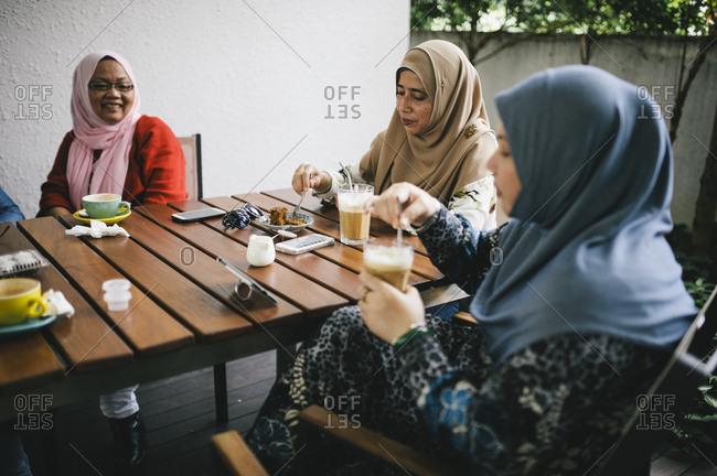 Women enjoying coffee and socializing, Malaysia