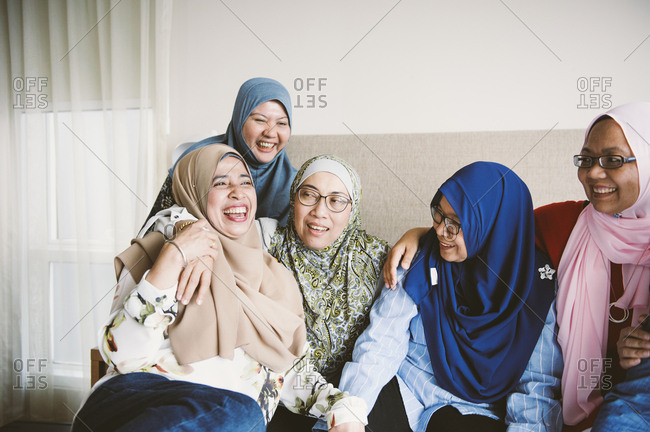 Smiling female friends in home, Malaysia