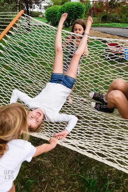 Children playing in hammock - Offset