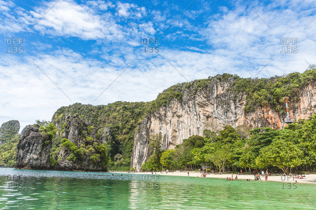 March 30, 2017 - Krabi, Thailand: Tourists swimming at a beach near cliffs