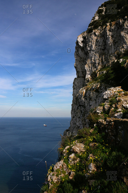 Boat visible from seaside cliffs in Gibraltar