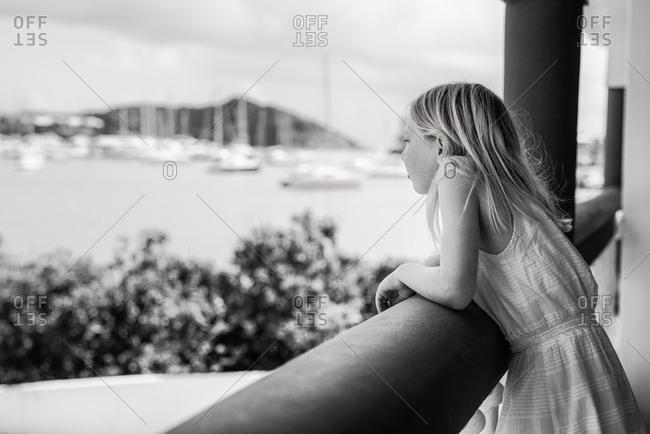 Girl looking out at sailboats on Saint Martin Island