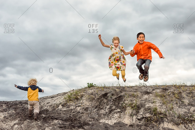 Kids jumping from a hill on Outer Banks, North Carolina