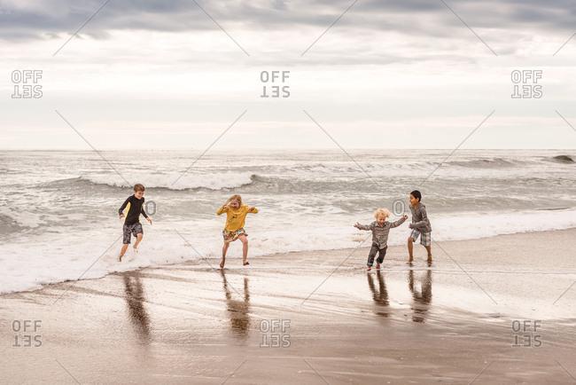 Kids playing on coast of Outer Banks, North Carolina