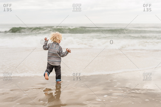 Boy in waves on beach on Outer Banks, North Carolina
