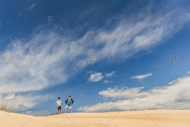 Two boys on a sandy hill in Jockey's Ridge State Park in North Carolina