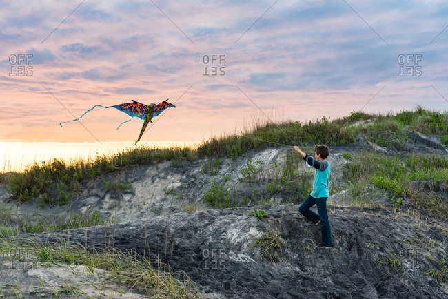 Boy flying a kite on the Outer Banks, North Carolina
