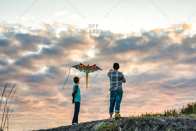 Father and son flying a kite on the Outer Banks, North Carolina