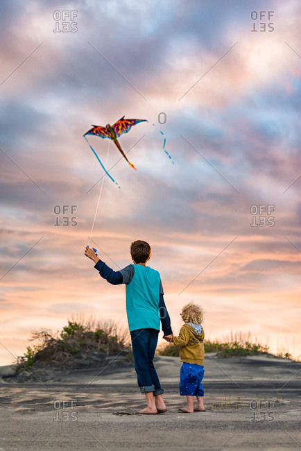 Boys flying a kite on the Outer Banks, North Carolina
