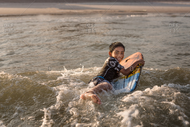 Boy on a boogie board in the ocean