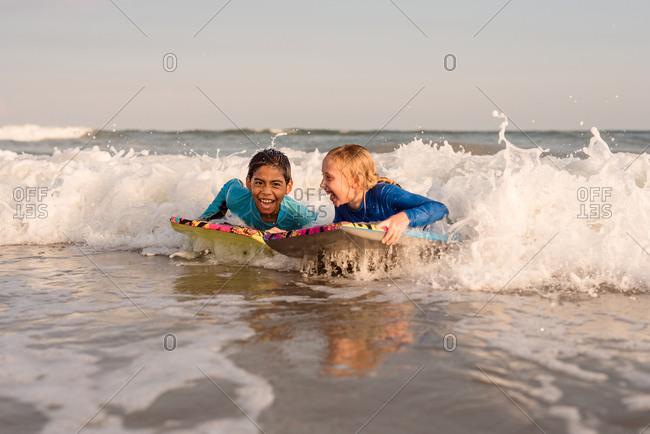 Children boogie boarding in the ocean