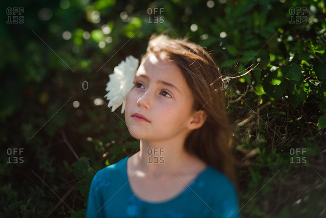 Portrait of a girl with brown hair and flower