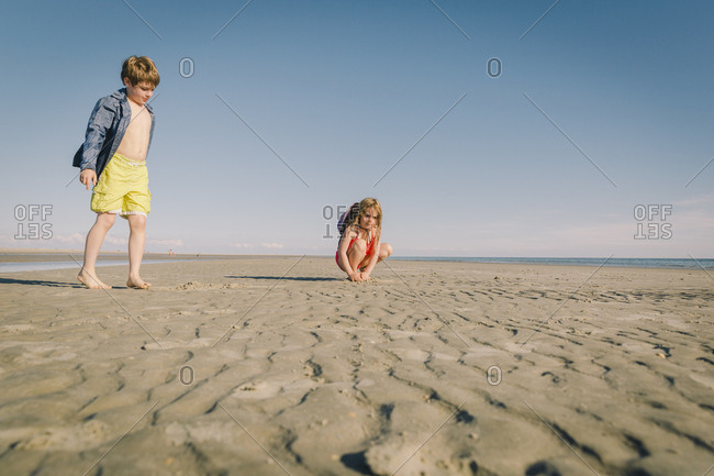 Brother and sister on a sandy beach