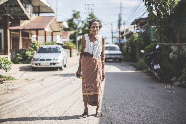 Thailand - June 20, 2015: Old Thai lady wearing a sarong