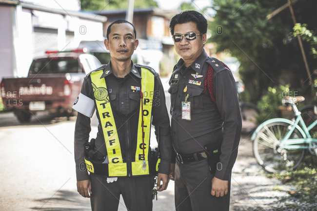 Thailand - June 20, 2015: Two Royal Thai police officers on duty on a street Thailand
