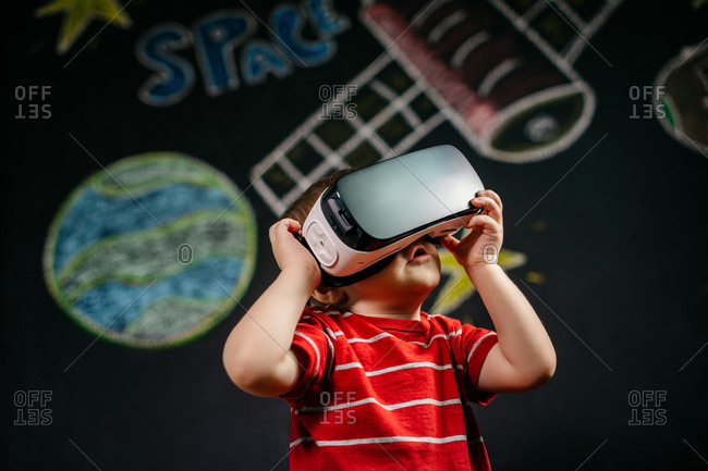 Little child having fun with virtual reality simulation