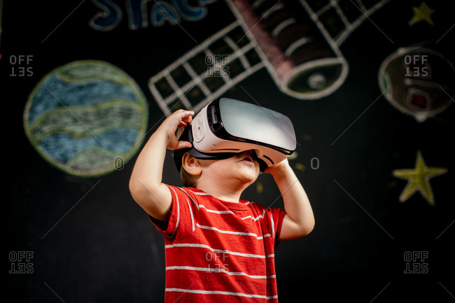 Child improving his skills and learning with virtual reality