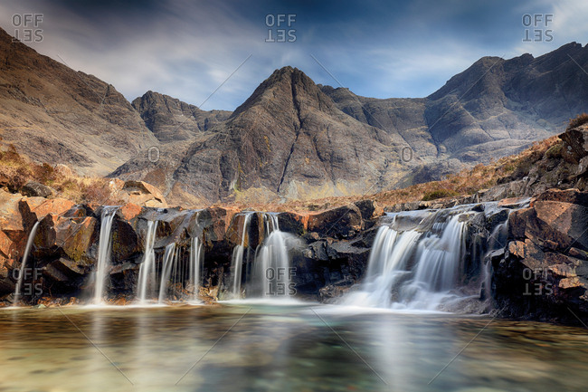 The Fairy pools waterfall and mountain scenery on a sunny day. Isle of Skye, Scotland.
