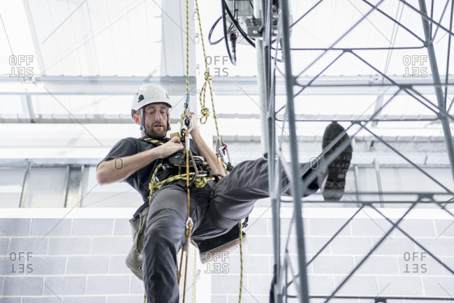 Transmission tower engineer training to climb in training facility