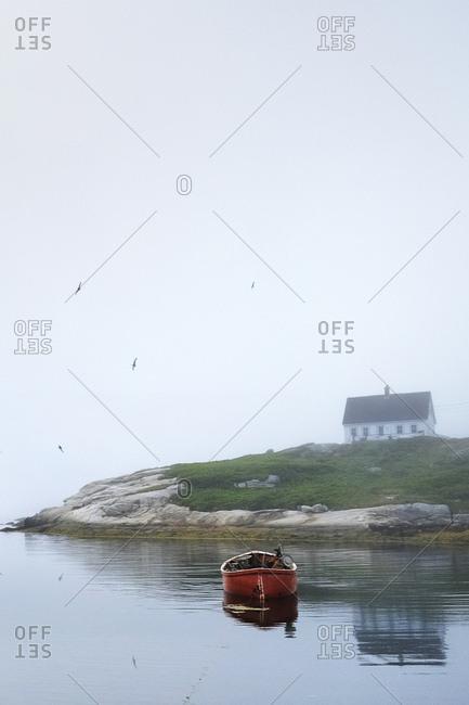 Empty rowboat on water, Peggy's Cove, Nova Scotia, Canada