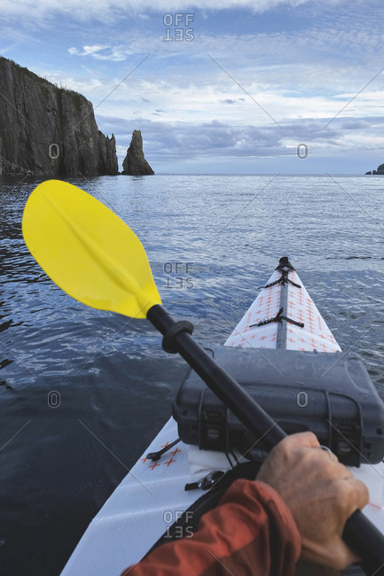 Point of view image of kayaker sea kayaking, Trinity Bay, Newfoundland, Canada