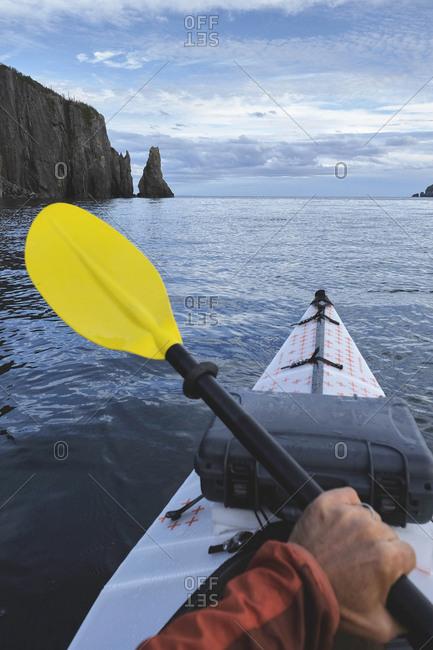 Point of view image of kayaker sea kayaking, Trinity Bay, Newfoundland, Canada