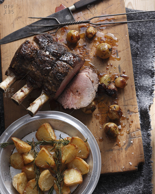 Roast beef with roast potatoes and onions