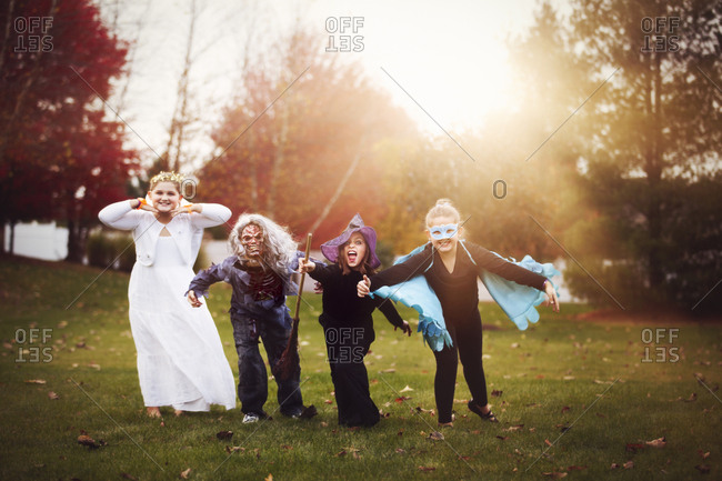Group of friends in Halloween costumes