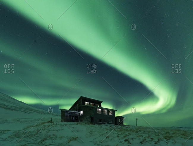 House under aurora borealis at night, Thingvellir, Iceland