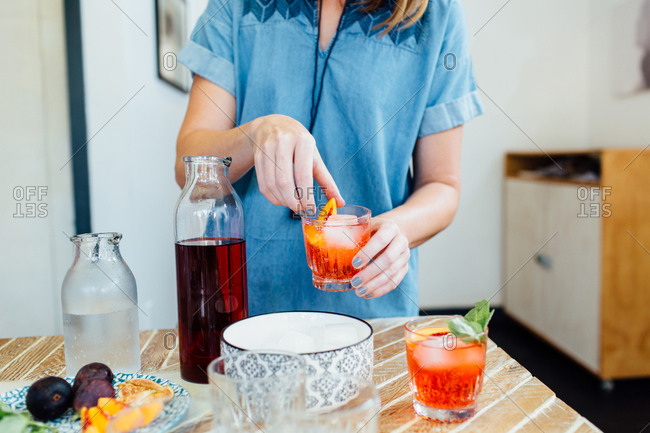 Woman preparing cocktail