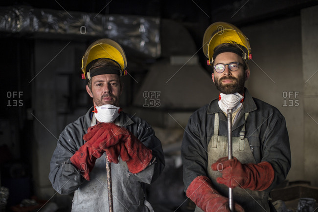 Portrait of metalworkers in foundry