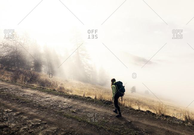 Young woman trekking along pathway, Missoula, Montana, USA