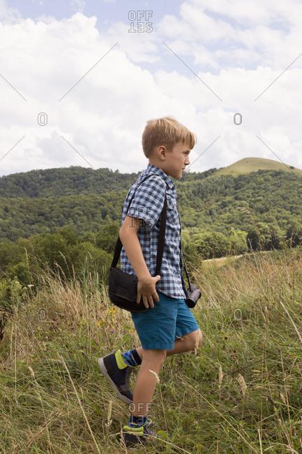 Young boy exploring outdoors