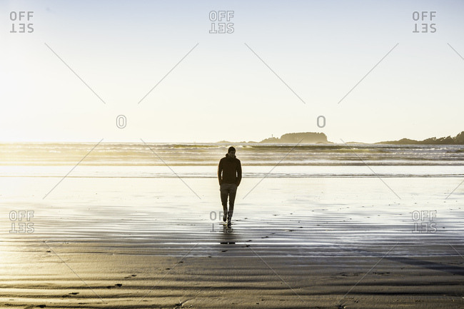 Man strolling on Long Beach, Pacific Rim National Park, Vancouver Island, British Columbia, Canada