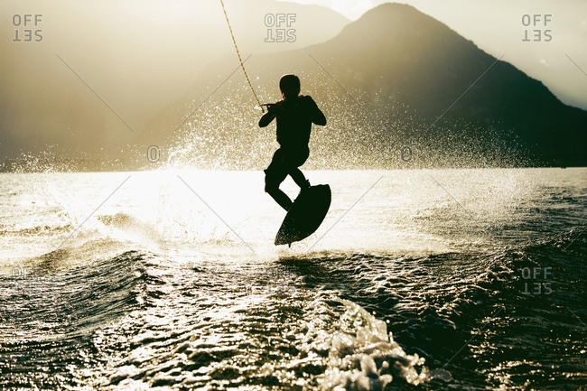 Silhouette of waterskier waterskiing, Maggiore lake, Verbania, Piedmont, Italy